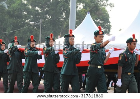 KUANTAN-AUG 31:Malaysians participate in National Day parade, celebrating the 58th anniversary of independence on August 31, 2015 in Kuantan, Pahang, Malaysia.