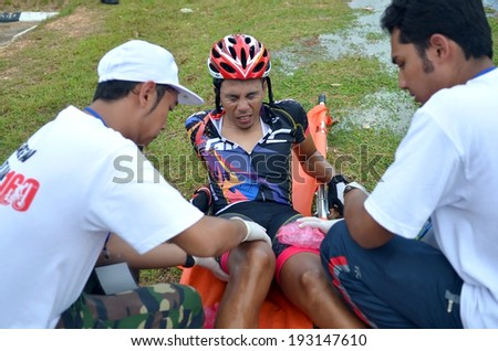 KUANTAN - FEBRUARY 6: unidentified cyclist in injury treatment during Kuantan160 on February 6, 2013 in Kuantan, Pahang, Malaysia. - stock photo