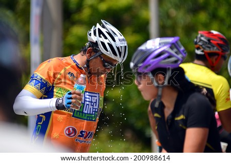 KUANTAN - FEBRUARY 6: unidentified cyclists enjoying the refreshment water during Kuantan160 ride on February 6, 2013 in Kuantan, Pahang, Malaysia. - stock photo