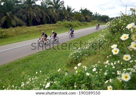 KUANTAN - FEBRUARY 6: unidentified cyclists in action during Kuantan160 on February 6, 2013 in Kuantan, Pahang, Malaysia. KUANTAN160 is a non-profit, non-race 160KM bicycle ride around Kuantan City. - stock photo