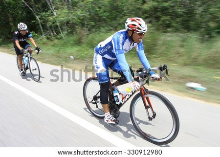 KUANTAN - JUNE 1: unidentified cyclists in action during Kuantan160 on June 1, 2014 in Kuantan, Pahang, Malaysia. KUANTAN160 is a non-profit, non-race 160KM bicycle ride around Kuantan City.