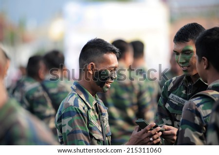 KUANTAN, MALAYSIA - AUGUST 31:Unidentified Royal Malaysia Defence Forces participate in National Day, celebrating 57th anniversary of independence on August 31, 2014 in Kuantan, Pahang, Malaysia.
