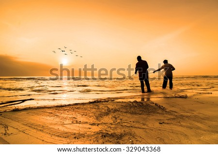 KUANTAN, MALAYSIA - JULY 20, 2014 - Fishermen do their work near Beserah beach, Kuantan, Malaysia at July 20, 2014. Fishermen are the main occupation for villagers at Kuantan village, Pahang - stock photo