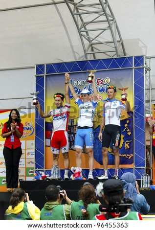 KUANTAN, MALAYSIA - MARCH 1: Three winners on stage for stage 7 race from Bentong to Kuantan of the Le Tour de Langkawi on March 1, 2012 in Kuantan, Malaysia.