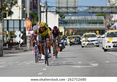 KUANTAN - MARCH 12: a group of cyclists in action during stage five of the 2015 Le Tour de Langkawi (LTdL) on March 12, 2015 in Kuantan, Pahang, Malaysia. - stock photo