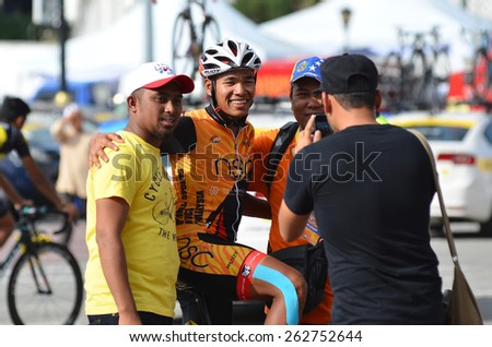 KUANTAN - MARCH 12: unidentified cyclist enjoying take the photograph with fans during stage five of the 2015 Le Tour de Langkawi (LTdL) on March 12, 2015 in Kuantan, Pahang, Malaysia. - stock photo