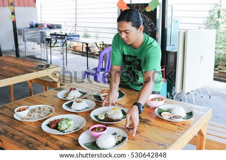 Kuantan Nov 17:A man arranged a position of Malaysia traditional foods on the table to be served. Malaysian traditional foods are one of the attractions to the tourists.