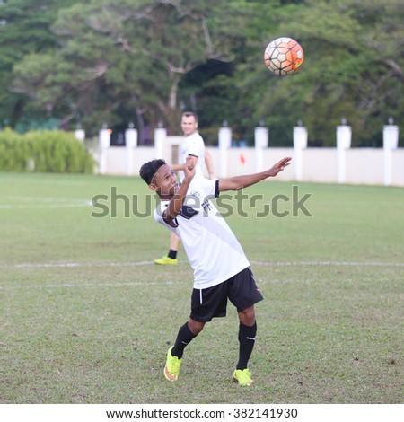 Kuantan, Pahang - JAN 28: Mohd Faisal heads the ball during the training Pahang FC Team at Taman Gelora field - stock photo