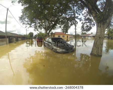 KUANTAN, PAHANG, MALAYSIA-DEC 05, 2014:Unidentified of condition a submerged vehicle after strucked by the worst floods in history - stock photo