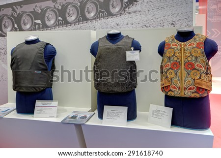 KUBINKA, MOSCOW OBLAST, RUSSIA - JUN 16, 2015: International military-technical forum ARMY-2015 in military-Patriotic park. The samples of body armor production Steel research Institute - stock photo