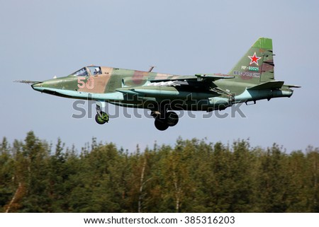 KUBINKA, MOSCOW REGION, RUSSIA - AUGUST 3, 2012: Sukhoi SU-25 attack plane of russian air force landing at Kubinka air force base during rehearsal for 100 years anniversary of russian air force.