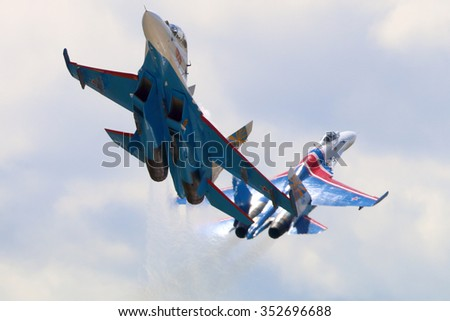 KUBINKA, MOSCOW REGION, RUSSIA - JUNE 17, 2015: Pair of Sukhoi Su-27 jet fighters of Aerobatics team Russian Knights at Kubinka air force base during Army-2015 forum - stock photo