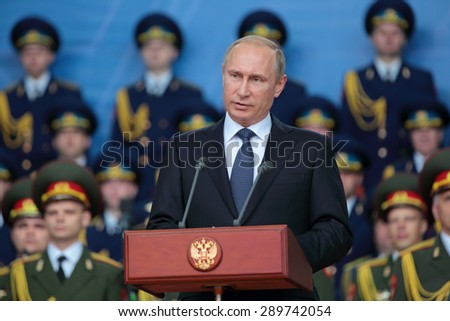 KUBINKA, RUSSIA - JUN 16, 2015: The President of the Russian Federation Vladimir Putin at the opening ceremony of the International military-technical forum ARMY-2015 in military-Patriotic park - stock photo