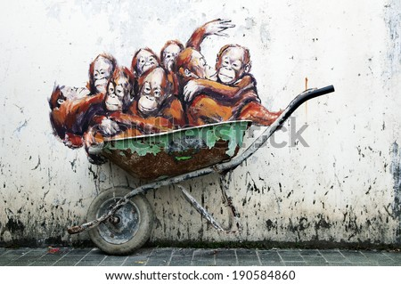 Kuching, Malaysia - April 27: Wall mural of orangutans in wheelbarrow painted by Lithuanian street artist Ernest Zacharevic along Jalan Power, Kuching, Sarawak on April 27, 2014.