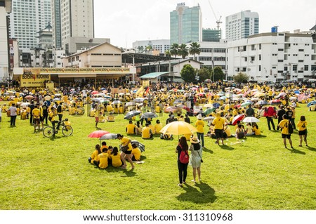 KUCHING,MALAYSIA - AUG 29, 2015: Crowds gathers at Bersih 4 rally in Song Kheng Hai field, Kuching,Sarawak.The objectives is to push for clean elections, good governance and the freedom of expression. - stock photo