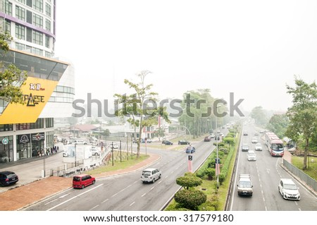 KUCHING, MALAYSIA - SEP 17, 2015 : Kuching has been hit with haze from open burning in the state and Kalimantan, Indonesia. The Air Pollutant Index rose to 205 as at 1200 pm, a very unhealthy level.