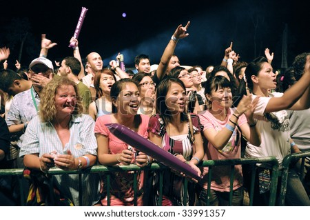 KUCHING, SARAWAK - JUL 11: Music fans at the 12th edition Rainforest World Music Festival, Sarawak Cultural Village on July 11, 2009 in Santubong, Sarawak.
