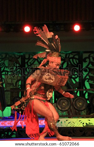 KUCHING, SARAWAK, MALAYSIA - SEPTEMBER 13: The Iban Warrior perform the ngajat (tribal dance) at the Sarawak Cultural Village on September 13, 2010 in Santubong, Sarawak. - stock photo
