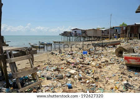 KUDAT, MALAYSIA - APRIL 02: Very dirty beach in fisher's village on April 02, 2012 in Kudat. - stock photo