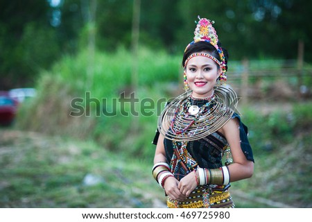Kudat, Sabah Malaysia. April 24, 2015: A girl from Rungus ethnic wearing traditional costume poses for the camera during the local Festival celeberation.