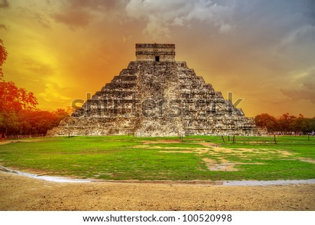 Kukulkan pyramid in Chichen Itza at sunset, Mexico - stock photo