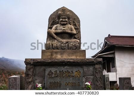 KUMAMOTO, JAPAN - SEPTEMBER 27, 2014: Statue of Japanese god near Aso Volcano, Kumamoto , Japan - stock photo