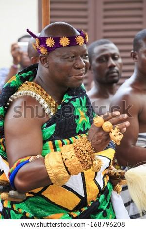 KUMASI, GHANA - NOVEMBER 11 - The Ashanti King, covered in gold, mingles with the crowd at the Adae Kese Ashanti festival. The festival is held every 42 days, Kumasi, Ghana - November 11, 2012 - stock photo