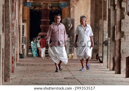 KUMBAKONAM, INDIA - JUL 14 : Unidentified devotees walk at the premises of  Kumbeshwarar temple on July 14, 2015 in Kumbakonam,India. The temple was built during the Chola dynasty in the 9th century.