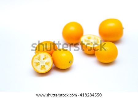 kumquat isolated on white background, selective focus half of kumquat orange fruit - stock photo