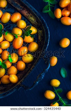 Kumquats Decorated On Table - stock photo
