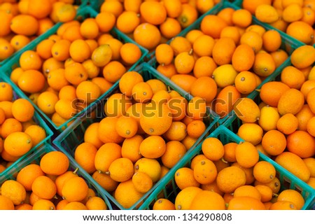 Kumquats in baskets - stock photo