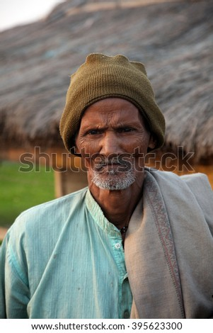 KUMROKHALI, INDIA - DECEMBER 02: Portrait of an unidentified day laborer December 02,2012 in Kumrokhali, India. These men sit on the street hoping to get day jobs not paid more than 2,5 dollars a day.