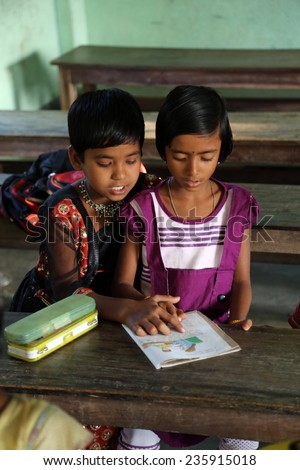 KUMROKHALI, INDIA - FEBRUARY 13, 2014: Kids learn at school. School name is the name of a famous Croatian missionary, Father Ante Gabric - stock photo