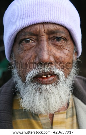 KUMROKHALI, INDIA - JANUARY 17: Portrait of an unidentified day laborer January 17, 2009 in Kumrokhali, India. These men sit on the street hoping to get day jobs not paid more than 2,5 dollars a day.