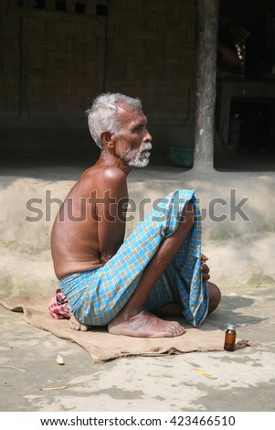 KUMROKHALI, INDIA - JANUARY 17: unidentified day laborer January 17, 2009 in Kumrokhali, India. These men sit on the street hoping to get day jobs not paid more than 2,5 dollars a day.