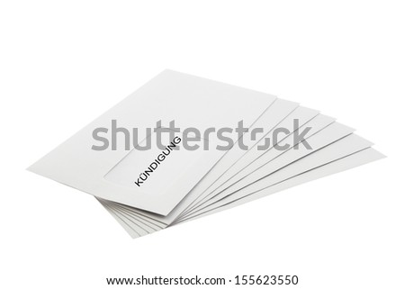 Kundigung (German dismissal) written on a Batch of Envelopes isolated on White Background