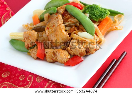 Kung Pao chicken.  Here's a homemade version of the Sichuan classic, sautaed with gluten free rice noodles - stock photo