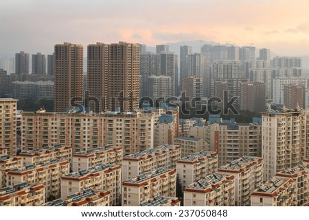 KUNMING, CHINA - DECEMBER 10: Construction on the outskirts of one of China's major cities, December 10, 2014, Kunming, China. China's economic boom leaves a trail of ghost cities.  - stock photo