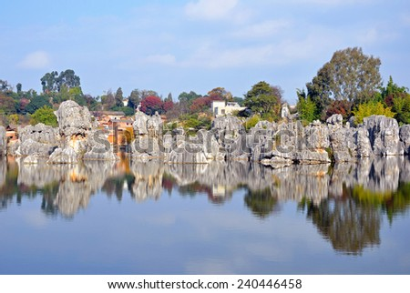 KUNMING, CHINA � DECEMBER 1, 2014: Stone Forest is a set of karst formations caused by the dissolution of limestone and are believed to be over 270 million years old. - stock photo