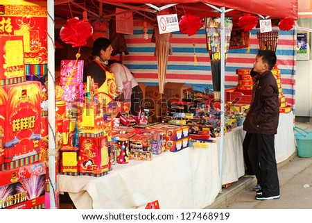 KUNMING, CHINA - FEB 7: Unidentified child buying fireworks in preparation for Chinese New Year celebrations in Kunming on Feb. 7, 2013. America imported $223 million in fireworks from China in 2011.