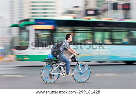 KUNMING-JULY 5, 2014. Man on a Lamborghini mountain bike. The iconic Italian brand is famous for its extravagant high performance cars, it even offers a niche mountain bike for its wealthy clients.  - stock photo
