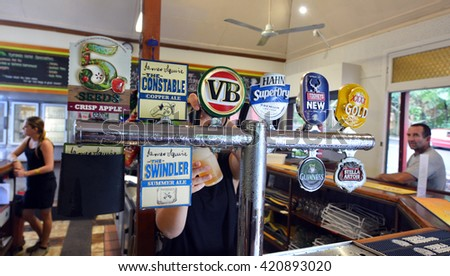 KURANDA, AUS - APR 16 2016:Selection of beers in Australian pub.There were almost 184 million litres of pure alcohol available for consumption in Australia in 2014 about 76 million litres was of beer.