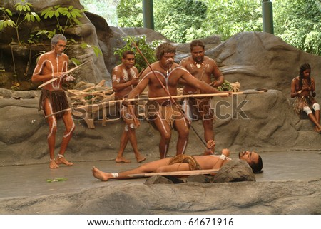 KURANDA, AUSTRALIA - MARCH 01: unidentified aborigines actors at a dance performance in the Tjapukai Culture Park on March 01, 2005 in Kuranda, Queensland, Australia - stock photo