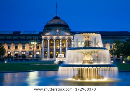 Kurhaus Wiesbaden with fountains at twilight, Hessen, Germany - stock photo