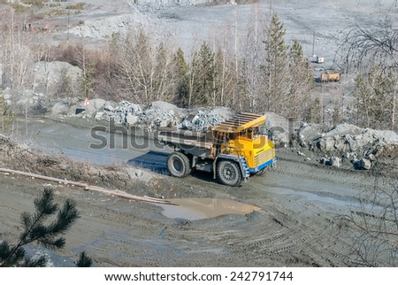 Kurmanka, Russia - April 10, 2010: Big truck transport stone ore for crushed stone production. Kurmansky crushed-stone pit. Sverdlovsk region