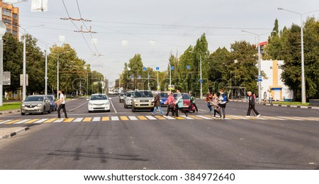 Kursk, Russia - October 2, 2015: People walk on a pedestrian crossing the street Karl Marx