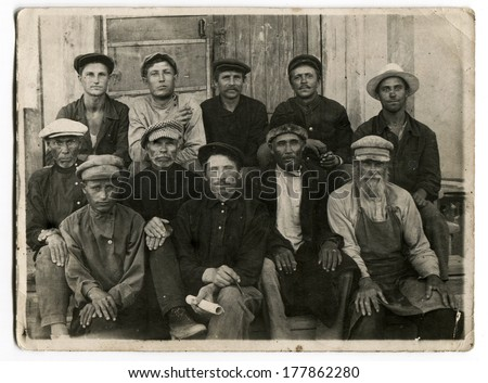 KURSK, USSR - CIRCA 1920s: An antique photo shows portrait of a group of peasants, members of the collective farm