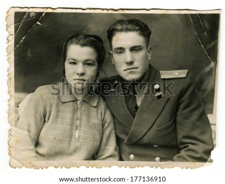 KURSK, USSR - CIRCA 1950s:  An antique photo shows  portrait of a Soviet officer and his wife.