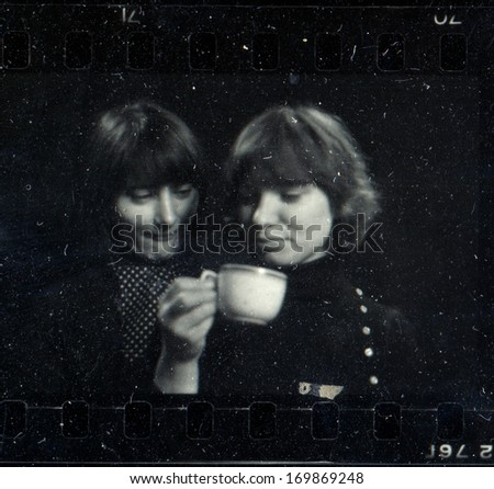KURSK,  USSR - CIRCA 1976: Vintage black and white studio photograph - two girlfriends, contact print off 35 mm Svema film, taken by Praktica super TL camera with Tessar 50mm/2.8 lens - stock photo