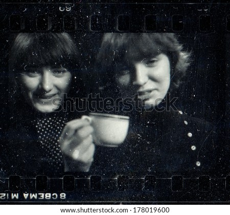 KURSK<  USSR - 1976: Vintage black and white studio photograph - two girlfriends, contact print off 35 mm Svema film, taken by Praktica super TL camera with Tessar 50mm/2.8 lens - stock photo